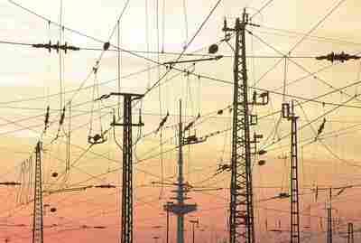 Sähköä ilmassa sunset behind power lines